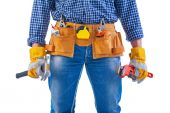 Tools in toolbelt and hands — Stock Photo