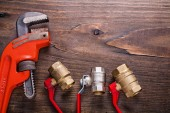 Plumbers fixtures and monkey wrench — Stock Photo