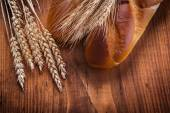 Two baguettes and ears of rye — Stock Photo