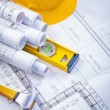 Blueprints, claw hammer and construction level — Stock Photo #69015661