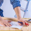 Hands of worker on table — Stock Photo #69016289