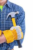 Claw hammer in hand with glove — Stock Photo