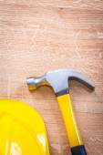 Claw hammer and yellow helmet — Stock Photo