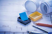 Pencil, compass, eraser and rolled blueprints — Stock Photo