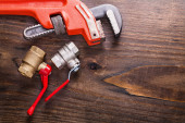 Monkey wrench and plumbers fixtures — Stock Photo