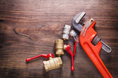 Two plumbers fixtures and monkey wrench — Stock Photo