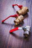 Plumbers fixtures with red handles — Stock Photo