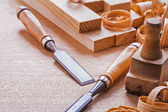 Chisels on wooden board — Stock Photo