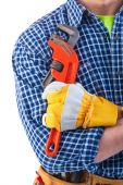 Construction worker holding monkey wrench — Stock Photo