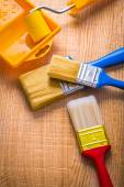 Paint brushes and tray on wooden board — Stock Photo