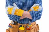 Crossed arms of construction worker — Stock Photo