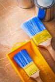 Paintbrushes with metalic paint cans — Stock Photo