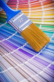 Paint brush on color palette — Stock Photo