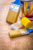 Set of paint brushes on wooden board — Stock Photo
