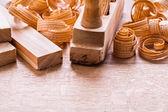 Plane shavings on wooden board — Stock Photo