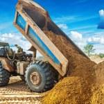 Tipper unloadding sand — Stock Photo #71281747