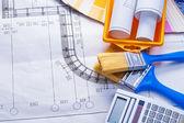 Paintoing tools on blueprint — Zdjęcie stockowe