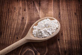 Wooden spoon with flour — Stock Photo