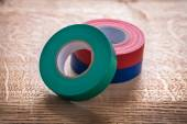 Rolls of insulating tape on wooden board — Stock Photo