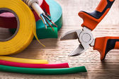 Electric cable rolls of isulating tape — Stock Photo