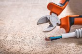 Opened nippers and electrical cable — Stock Photo