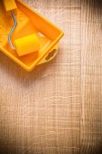 Paint roller in tray on wooden board — Stock Photo