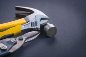 Adjustable wrench claw hammer — Stock Photo