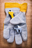 Adjustabe wrench and protective glove — Stock Photo