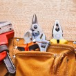 Set of working tools on wooden board — Stock Photo #72700159
