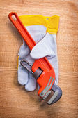 Monkey wrench with protective  glove — Stock Photo