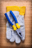 Pliers with protective working glove — Foto de Stock