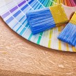 Paint brushes on color palette — Stock Photo #72715987