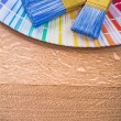 Paint brushes on color palette — Stock Photo #72716001