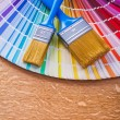 Paint brushes on color palette — Stock Photo #72716009