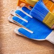 Paint tray brushes duct tape and protective gloves — Stock Photo #72716067