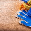 Gloves duct tape paint tray and brushes — Stock Photo #72716141