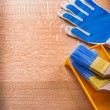 Gloves with paint tray and brushes — Stock Photo #72716155