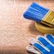 Safety gloves duct tape with paintbrush — Stock Photo #72716181