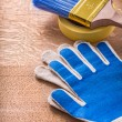 Safety gloves duct tape with paintbrush — Stock Photo #72716183