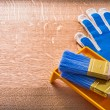 Gloves paint tray and brushes — Stock Photo #72716481