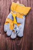 Adjustable spanner and protective glove — Stock Photo