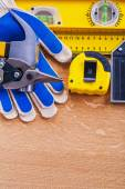 Construction level protective gloves hammer — Stock Photo