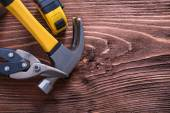 Claw hammer nippers and tape-measure — Stock Photo
