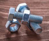 Stainless bolts and screw nuts — Stock Photo