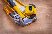 Cutting pliers claw hammer construction level — Stock Photo