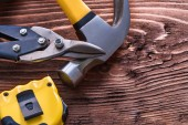 Metal claw, hammer, nippers and tape-line — Stock Photo