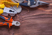 Nippers, pliers, wire-cutter, and  glove — Foto de Stock