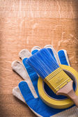 Paint brush and duct tape on gloves — Stock Photo