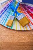 Paint brushes on color palette — Stock Photo