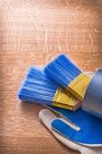 Paint brushes in duct tape on gloves — Stock Photo